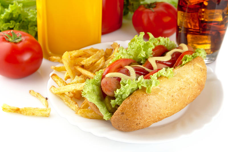 Download Hotdog With Lettuce,tomatoes And Cucumber On Plate On White Stock Photo - Image: 83711556