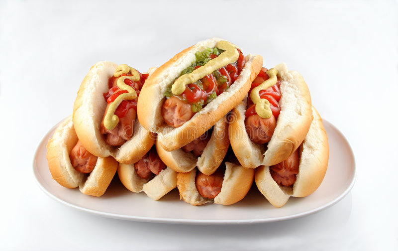 Hotdogs 2. Plate of stacked hotdogs. Ketchup, mustard, and relish