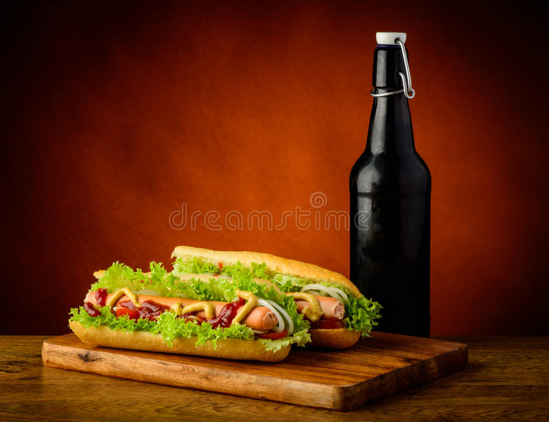 Hotdogs and beer stock photography
