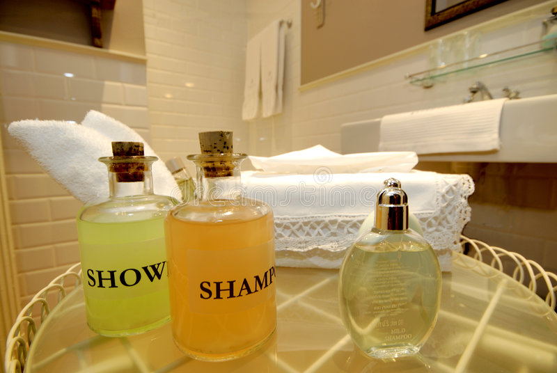 Hotel bathroom. With in close up shower gel and shampoo royalty free stock image