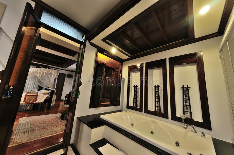 Hotel bathroom. Thai Style Hotel bathroom with bathtub royalty free stock photos