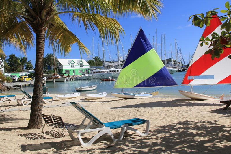 Hotel Beach on Falmouth Harbour Marina Antigua. Wind surfing boards sitting on a hotel beach near Falmouth Harbour Marina in Antigua Barbuda royalty free stock images