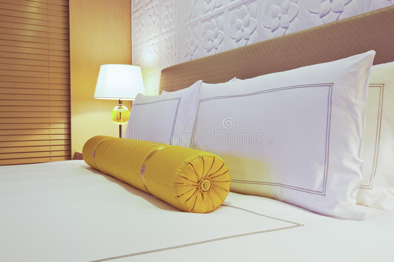 Hotel bed royalty free stock photos