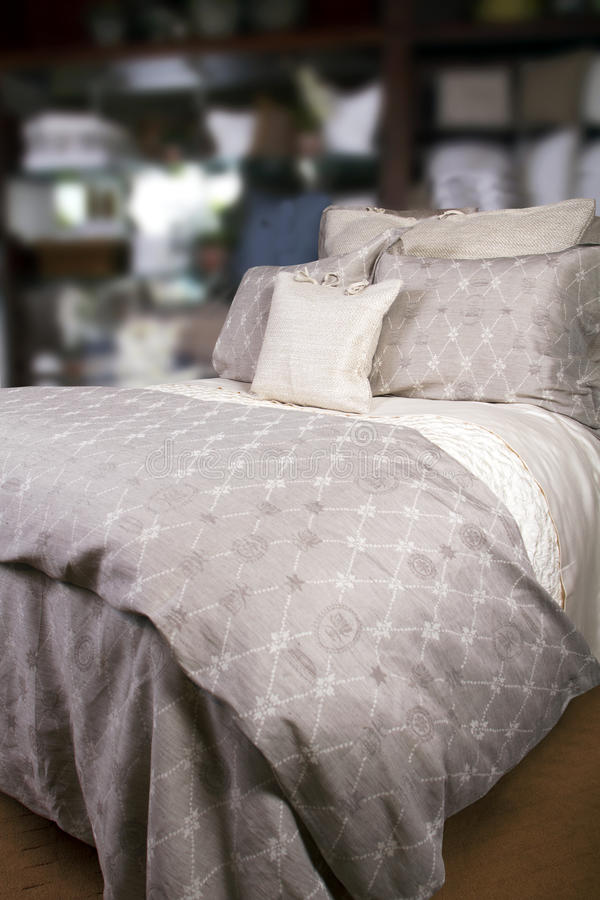 Hotel Bed With Comforter And Pillows Royalty Free Stock Images