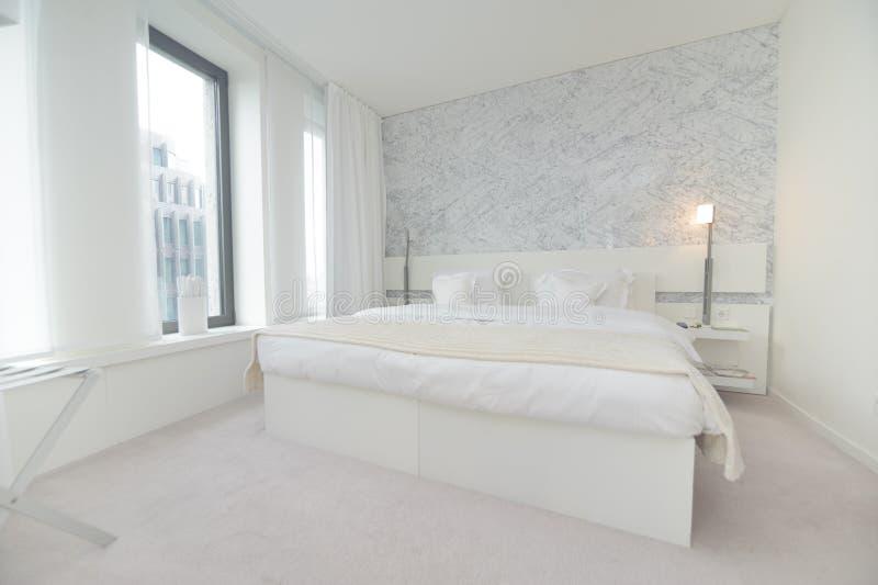 Hotel bedroom. White hotel bedroom in Berlin royalty free stock images