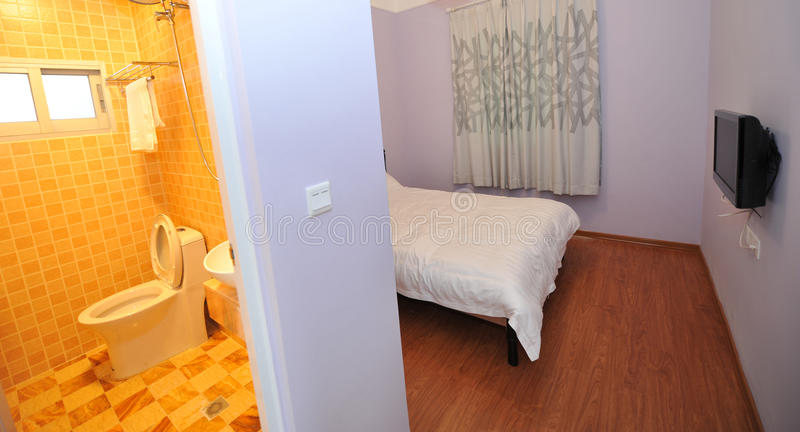 Hotel bedroom and bathroom. Bathroom and bedroom in the interior of a hotel stock photos