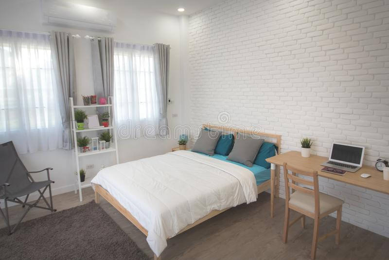 Download Hotel Bedroom Interior Design. White Bedroom Setting Studio For  Rent. Stock Photo