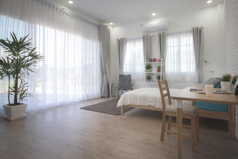 Download Hotel Bedroom Interior Design. White Bedroom Setting Studio For  Rent. Stock Image