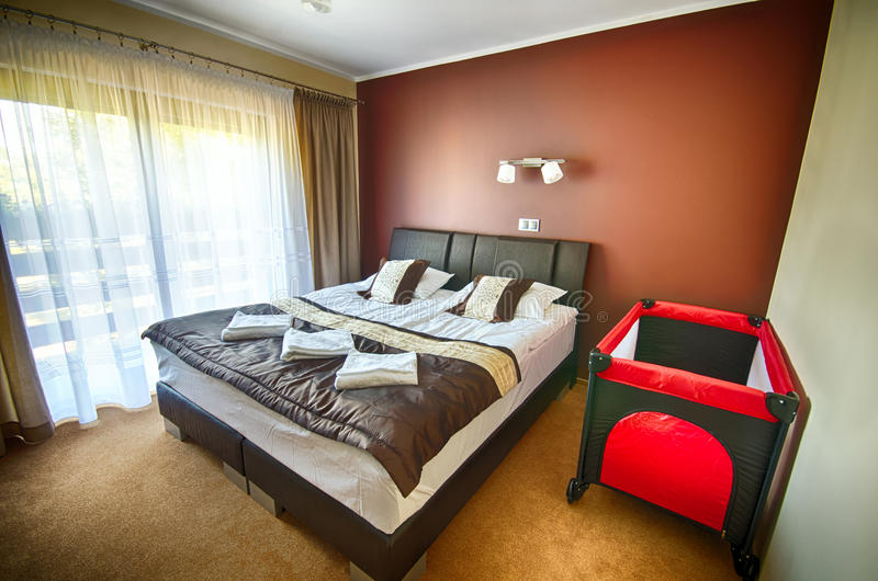 Hotel bedroom with playpen stock photos