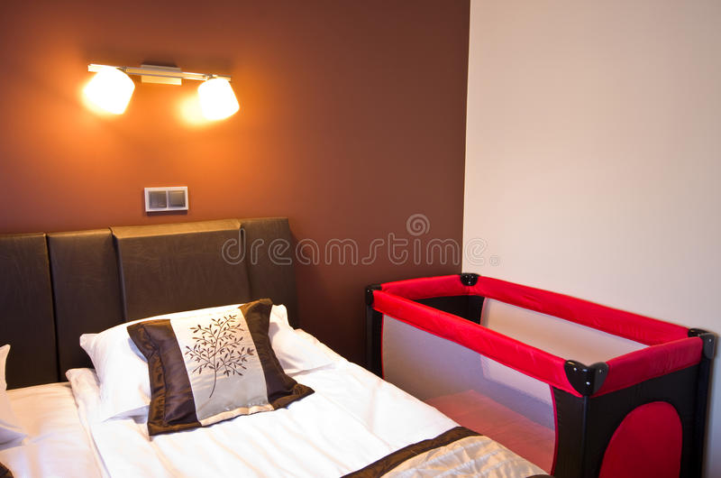 Hotel bedroom with playpen stock images