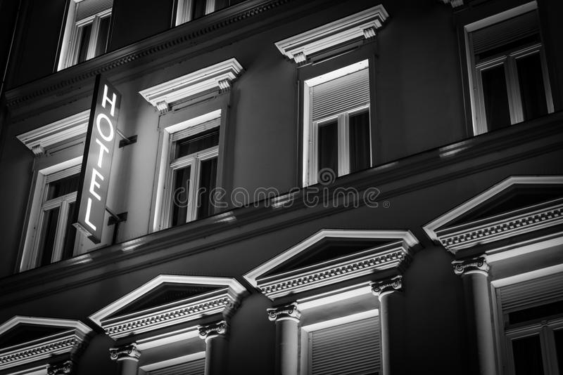 Hotel building in Budapest, Hungary, Europe. Glowing hotel sign in night on old building. Architecture of Budapest, Hungary, Europe, travel stock photography