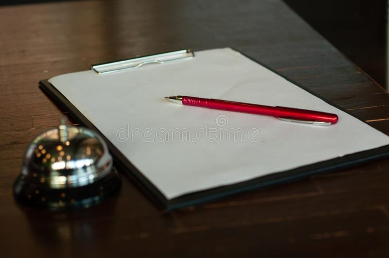 Hotel business Check-in. Hotel business Bell registration, registration book royalty free stock photo