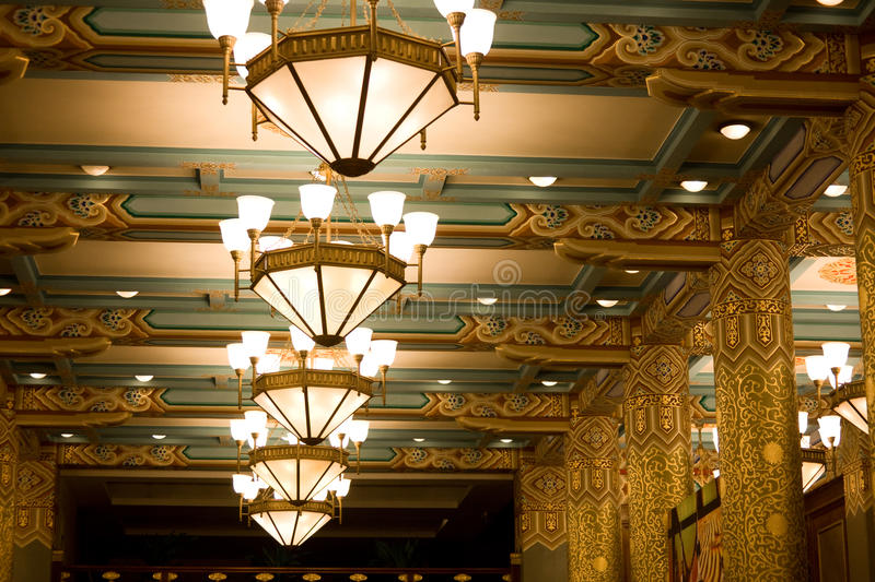 Hotel ceiling with chandelier royalty free stock image