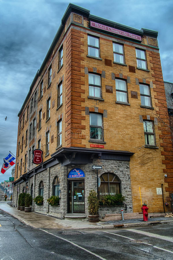 Hotel Champs de Mars. Nestled among other historic buildings at the gateway to Old Montreal, Hotel Champ de Mars offers a prime location, an inviting and warm stock photo