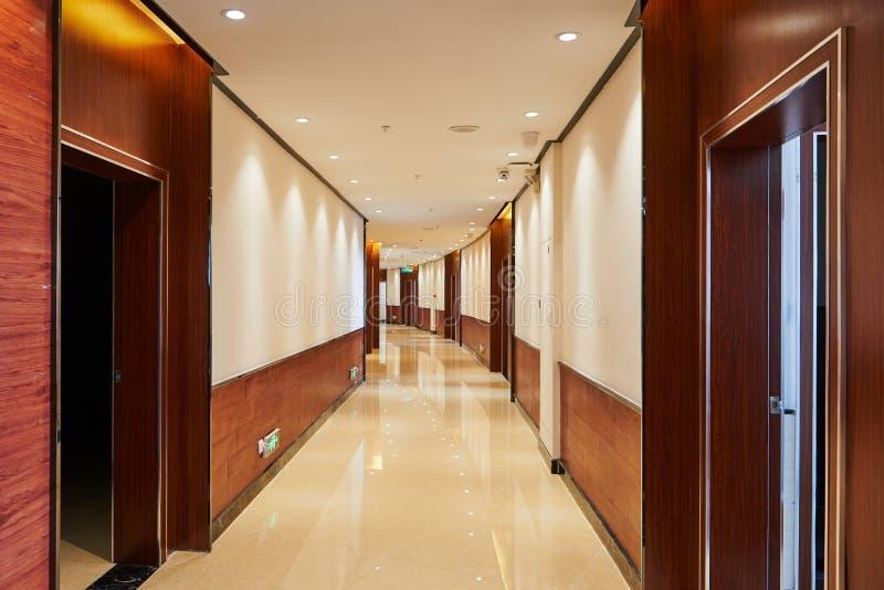 Hotel corridor lobby. Hotel corridor illuminated by spot led light at night royalty free stock photography