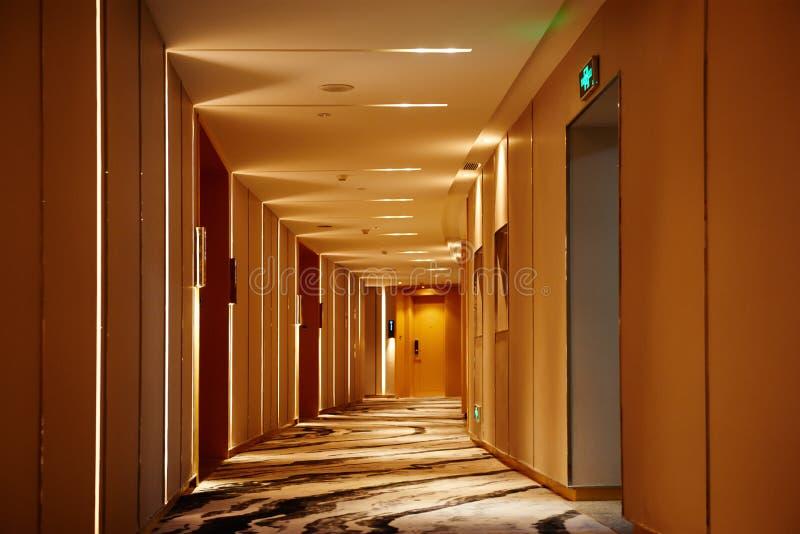 Hotel corridor lobby. Hotel corridor illuminated by strip led light at night stock photography