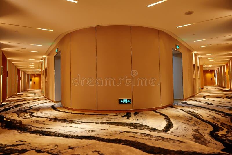 Hotel corridor lobby. Hotel corridor illuminated by strip led light at night royalty free stock photography
