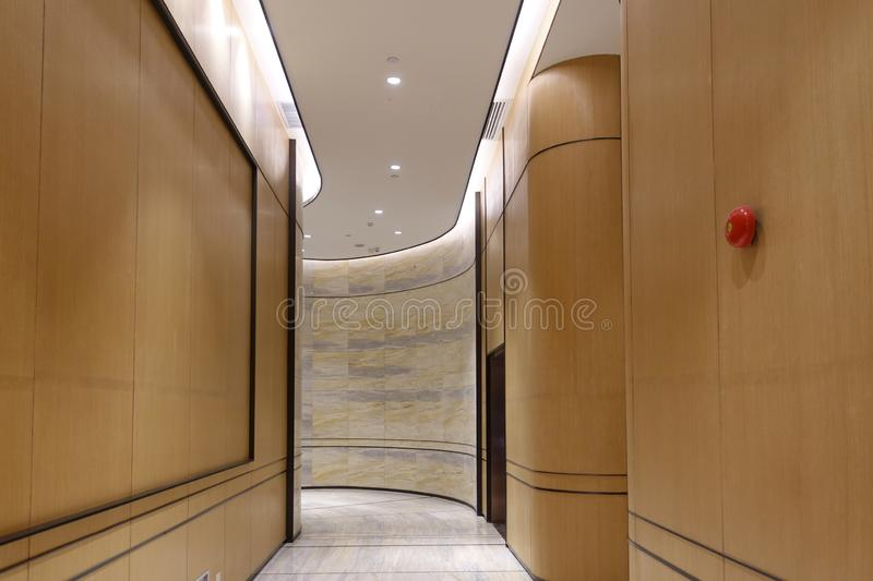 Hotel corridor lobby commercial building interior. Hotel corridor illuminated by strip led light at night royalty free stock images