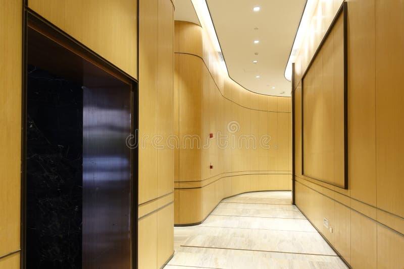 Hotel corridor lobby commercial building interior. Hotel corridor illuminated by strip led light at night stock photo