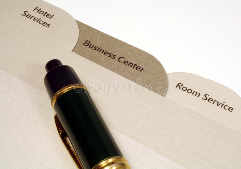 Hotel Directory and Pen. This is a close up image of three tabs from a hotel room directory and a Pen royalty free stock photo