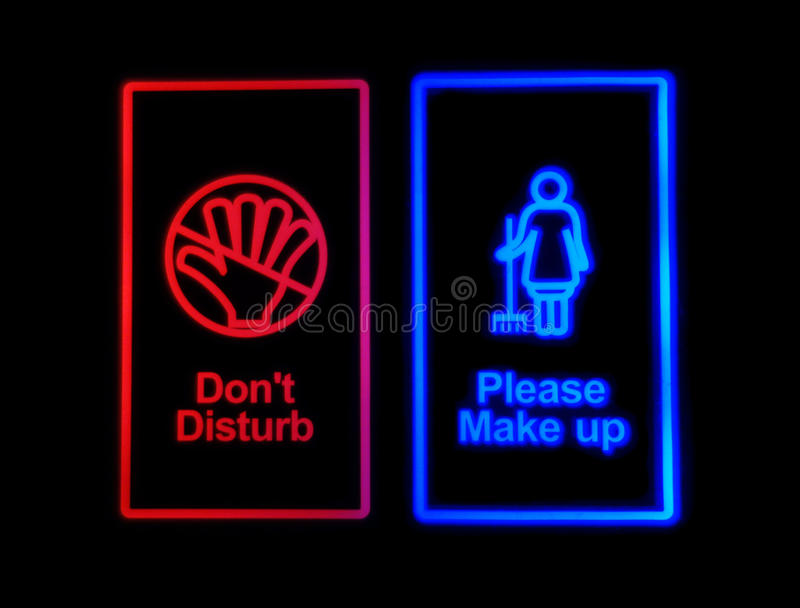 Hotel electronic sign Do not disturb. Or Please make up on black background royalty free stock photo