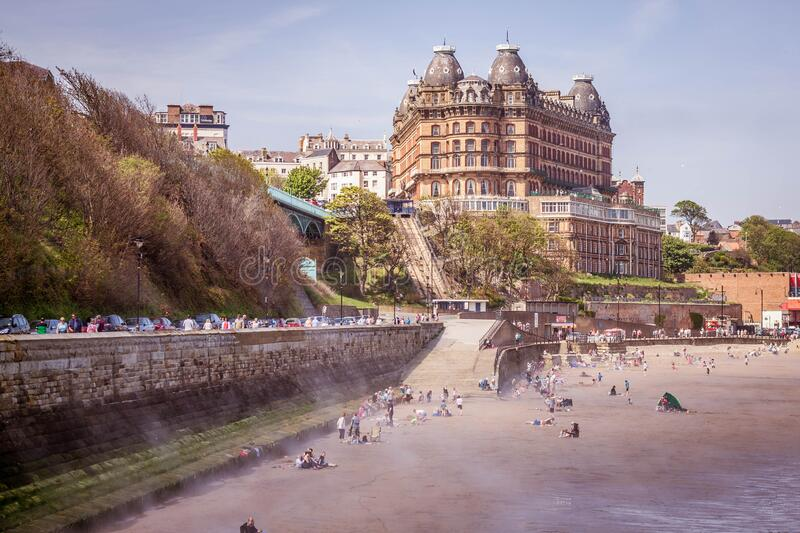 Hotel on the English coast. The city of Scarborough in the United Kingdom. Vacationers on the Sunny beach royalty free stock images