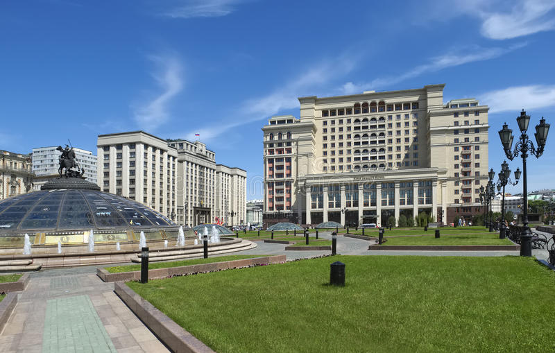 Hotel Four Seasons Hotel Moscow. Five-star hotel Four Seasons Hotel Moscow and the State Duma of the Russian Federation, the view from Manezhnaya Square royalty free stock photos