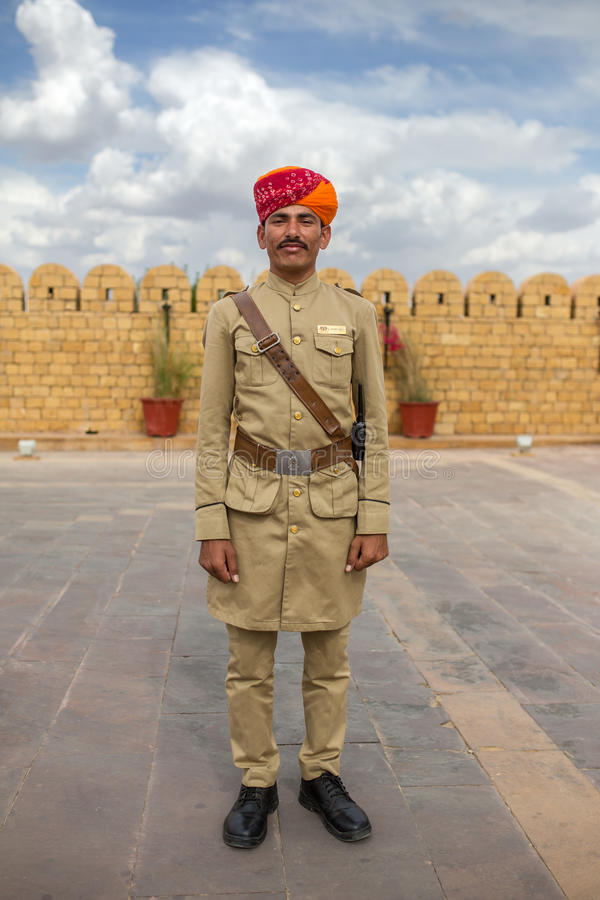 Hotel guard with moustache and traditional rajasthani turban posing for photo. stock photo