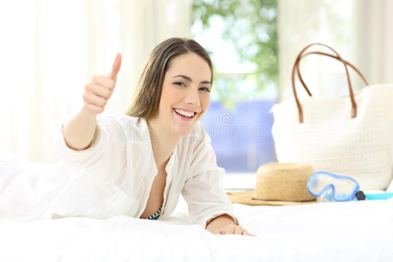 Hotel guest with thumbs up on summer holidays stock photos