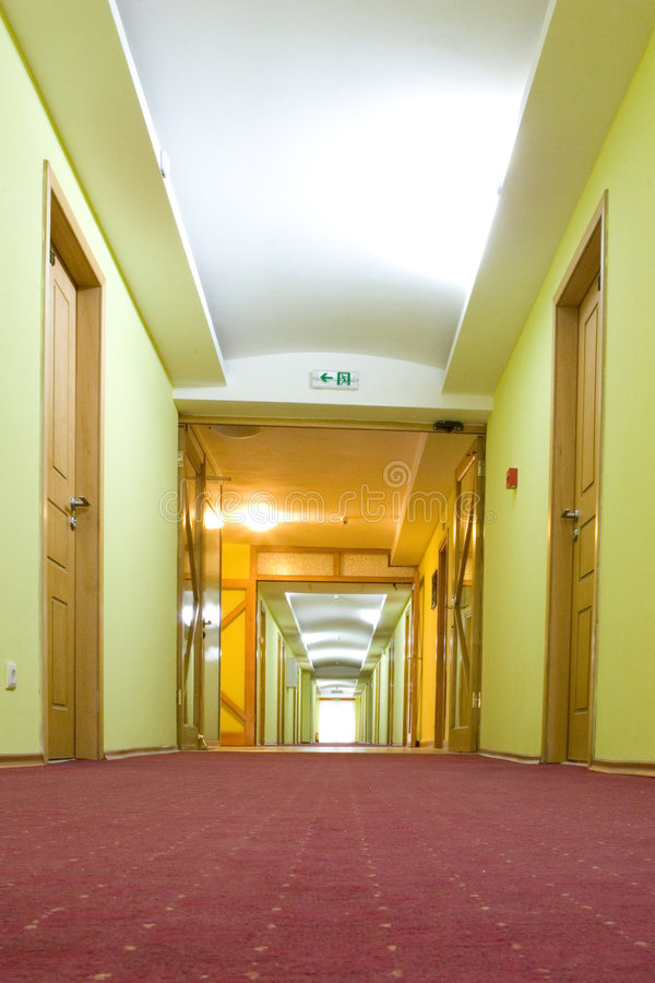 Hotel hallway. Long hotel hallway in red, yellow and white