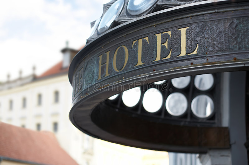 Hotel header. Close up of hotel header incription. Golden letters. Shallow DOF royalty free stock photos