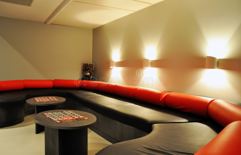 Hotel Interior. Black and red couch on hotel room royalty free stock photos
