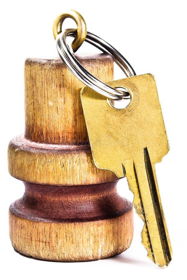 Hotel keys. Hotel/hostel keys with wood appendage on white isolated background stock photography