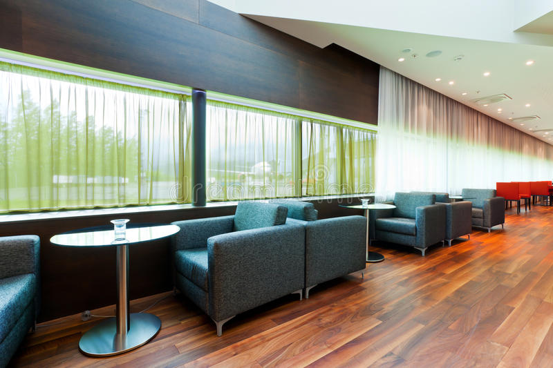 Hotel lobby. Interior of a airport hotel lobby, with a view to a plane on the outside