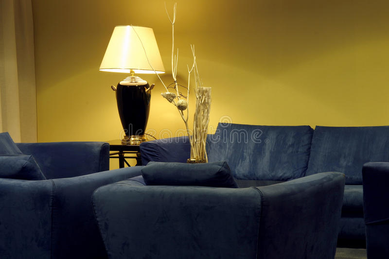 Hotel lobby with comfortable blue couches stock photography