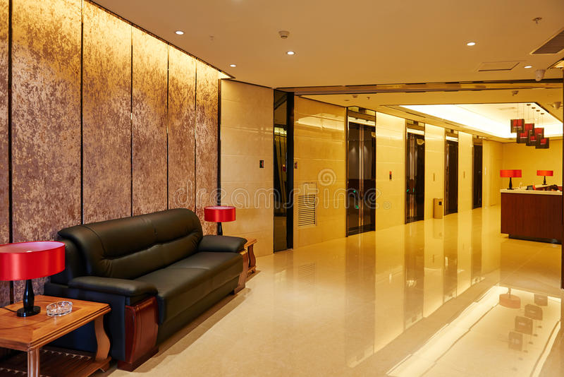 Hotel lobby and elevator doors furniture stock photos