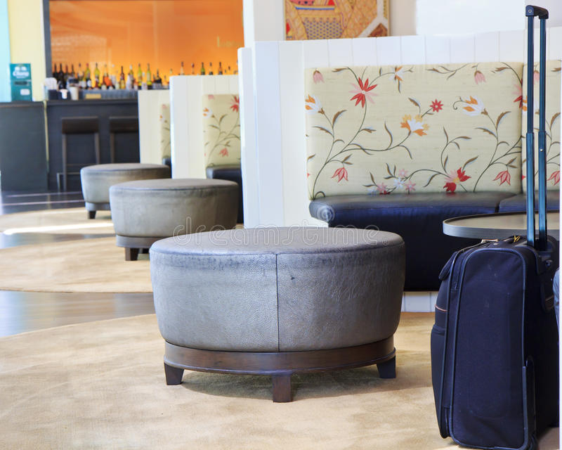 Hotel lobby with huge luggage.  stock photo
