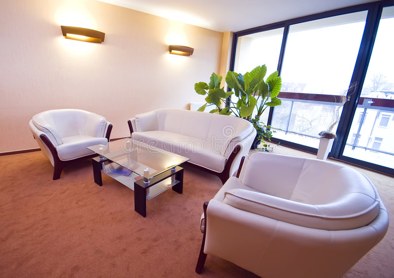 Hotel lobby sofas. Comfortable sofas in a hotel lobby royalty free stock photography