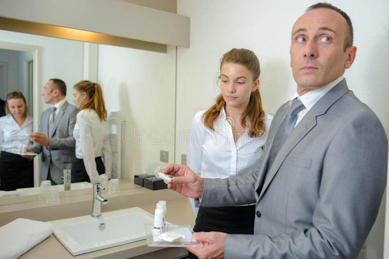 Hotel manager or receptionist checking hotel room. Hotel manager or receptionist checking a hotel room stock photos