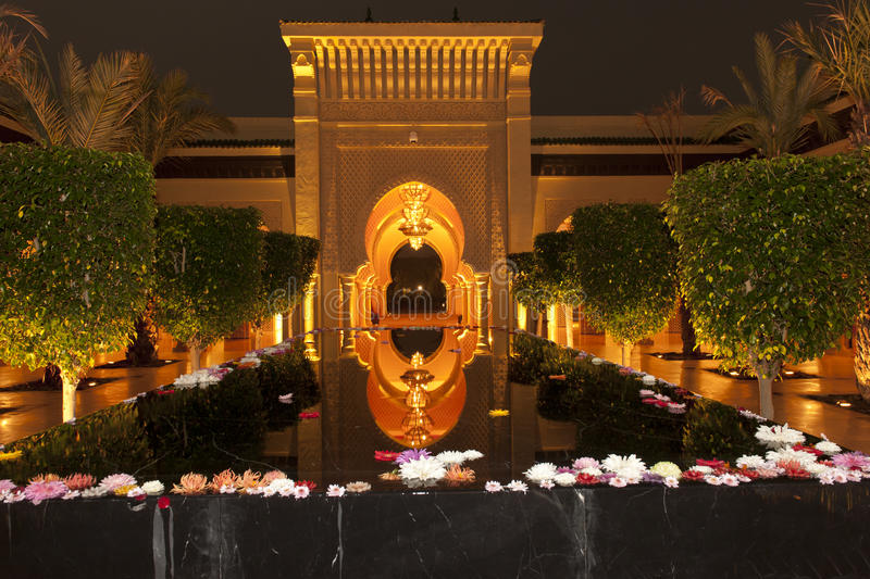 Lighted oriental entrance and water basin of Hotel Mazagan Beach Resort, Morocco stock photography