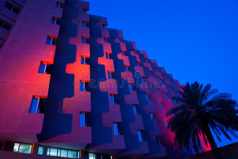 Hotel at night. Tropical hotel illuminated in red at night stock photo