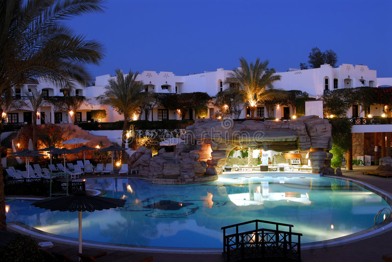 Hotel at night. Hotel with pool captured by night stock photos