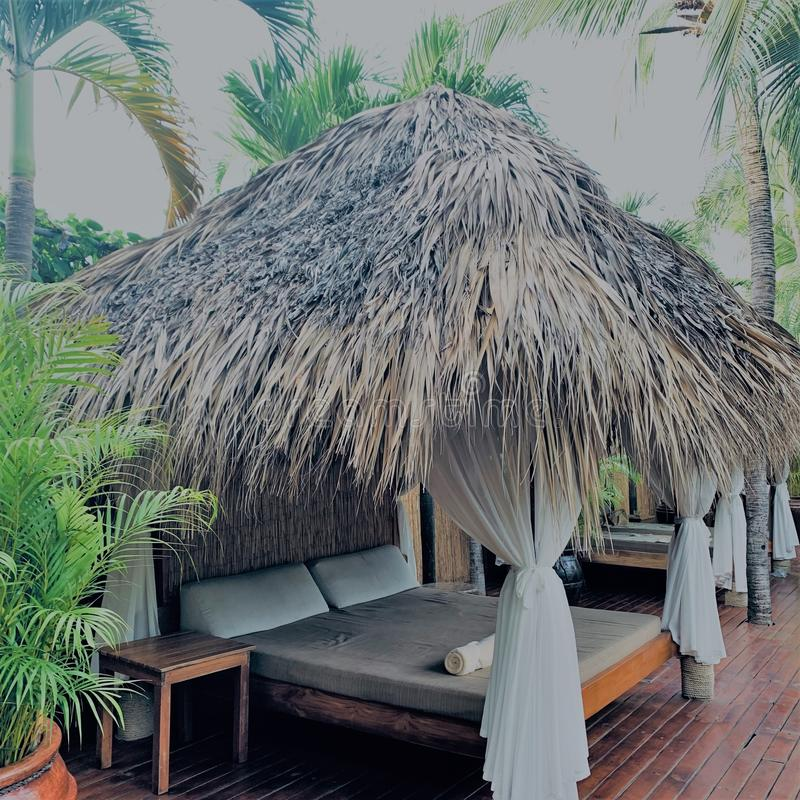Hotel outdoor furniture. Tropical daybed as hotel outdoor furniture royalty free stock photos
