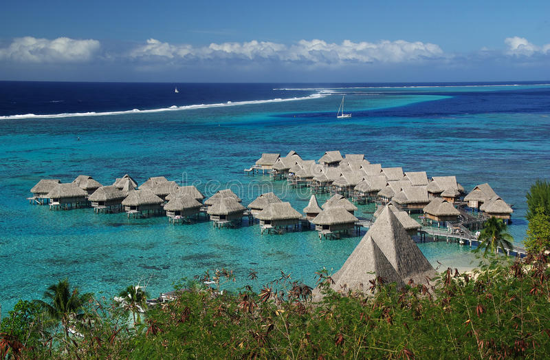 Hotel over the turquoise lagoon in Bora Bora. 5 star hotel of Tahiti with bungalows on stillts over the lagoon and the cristal water royalty free stock photo