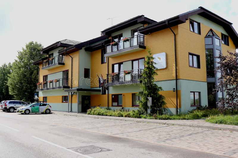 Hotel and parking lot in Ikskile, Latvia. Hotel Spadrops in Ikskile, Latvia with Google Maps Street View Car parked in the parking lot off the street in front of stock photos