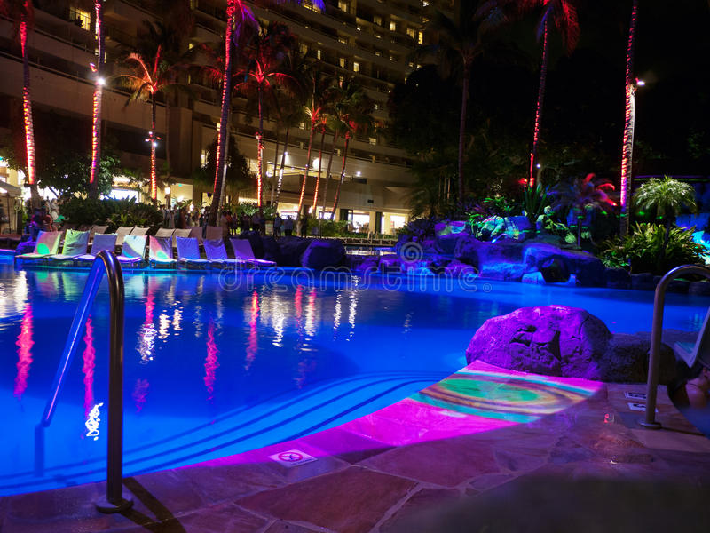 Hotel pool at night with colorful lights stock image for Pool light show waikiki