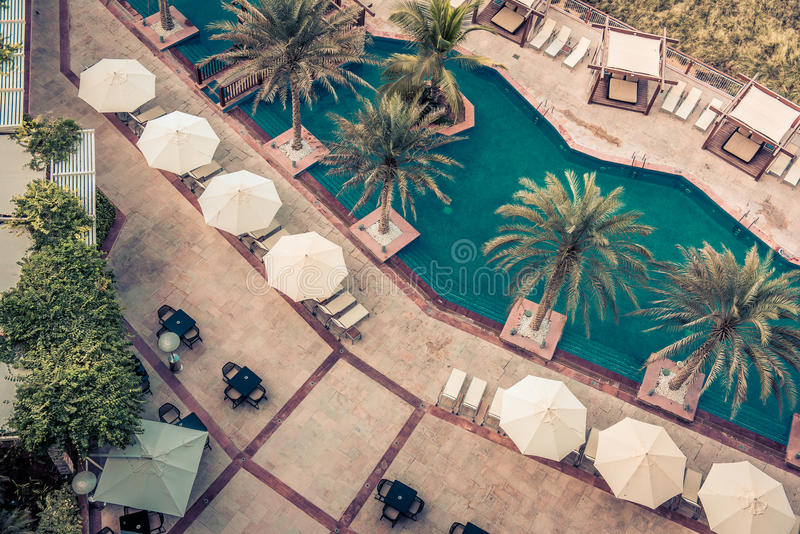 Hotel Poolside with Parasols and Palms stock photo