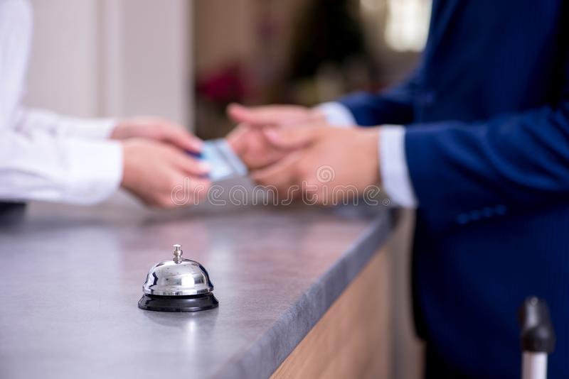 Hotel reception bell at the counter. The hotel reception bell at the counter royalty free stock image