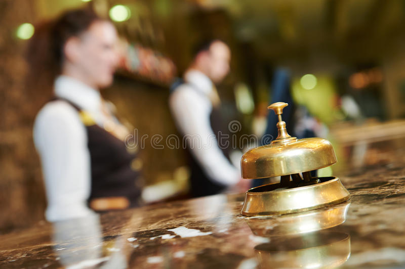 Hotel reception with bell stock photography