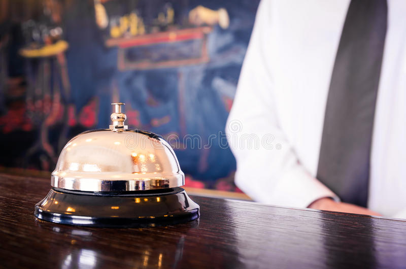 Hotel reception service bell with concierge royalty free stock photography